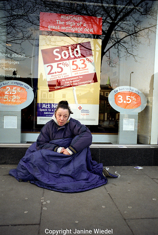 Homeless woman begging in Islington North London.