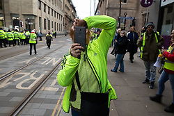 "© Licensed to London News Pictures . 05/01/2019. Manchester, UK. A Yellow Vest demonstration takes place in St Peter's Square in central Manchester . The protest was organised via YouTube account "" Tommy Robinson News "" and was called in the wake of stabbings at Manchester Victoria Train Station on New Year's Eve . Protesters chanted in favour of Brexit , against police and press and carried pro-Trump and EDL clothing and placards . Photo credit : Joel Goodman/LNP"