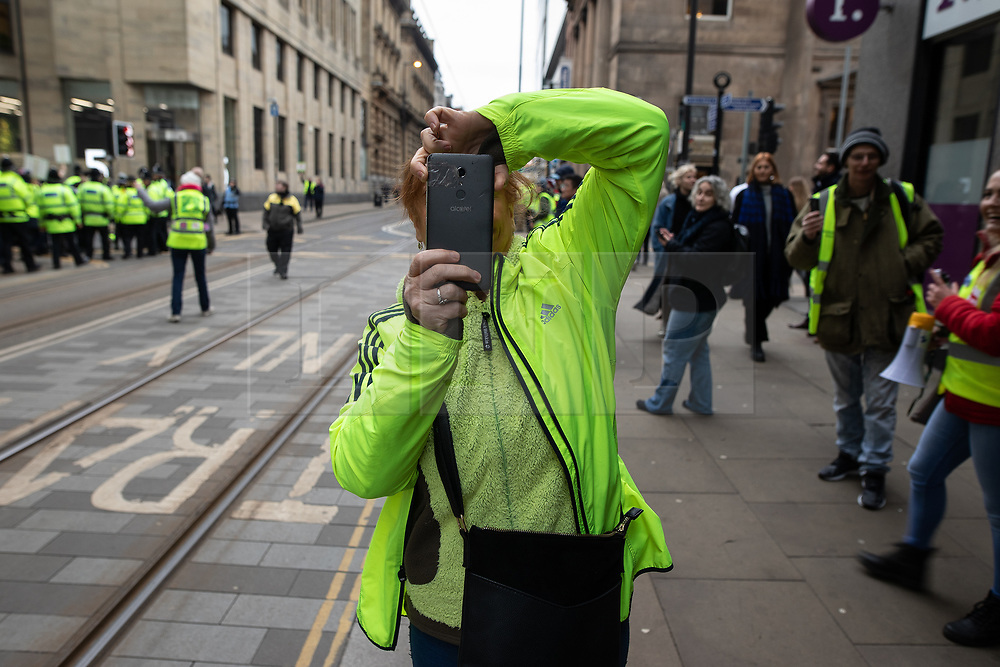 """© Licensed to London News Pictures . 05/01/2019. Manchester, UK. A Yellow Vest demonstration takes place in St Peter's Square in central Manchester . The protest was organised via YouTube account """" Tommy Robinson News """" and was called in the wake of stabbings at Manchester Victoria Train Station on New Year's Eve . Protesters chanted in favour of Brexit , against police and press and carried pro-Trump and EDL clothing and placards . Photo credit : Joel Goodman/LNP"""