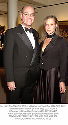 The HON.SIMON HOWARD and his fiancŽ the HON.REBECCA SIEFF, at a dinner in London on 17th May 2001.	OOH 6