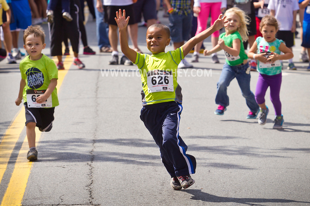 Middletown, New York - Children compete in a kids race at the Middletown YMCA Funzone  during the Orange Regional Medical Center's Run 4 Downtown road race on Aug. 16, 2014.