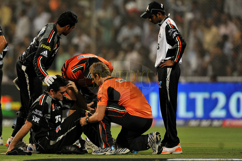 Graeme Smith of Pune Warriors India is attended by team doctor after the collide with Rahul Sharma of Pune Warriors India during  match 10 of the Indian Premier League ( IPL ) Season 4 between the Pune Warriors and the Kochi Tuskers Kerala held at the Dr DY Patil Sports Academy, Mumbai India on the 12th April 2011..Photo by Pal Pillai /BCCI/SPORTZPICS