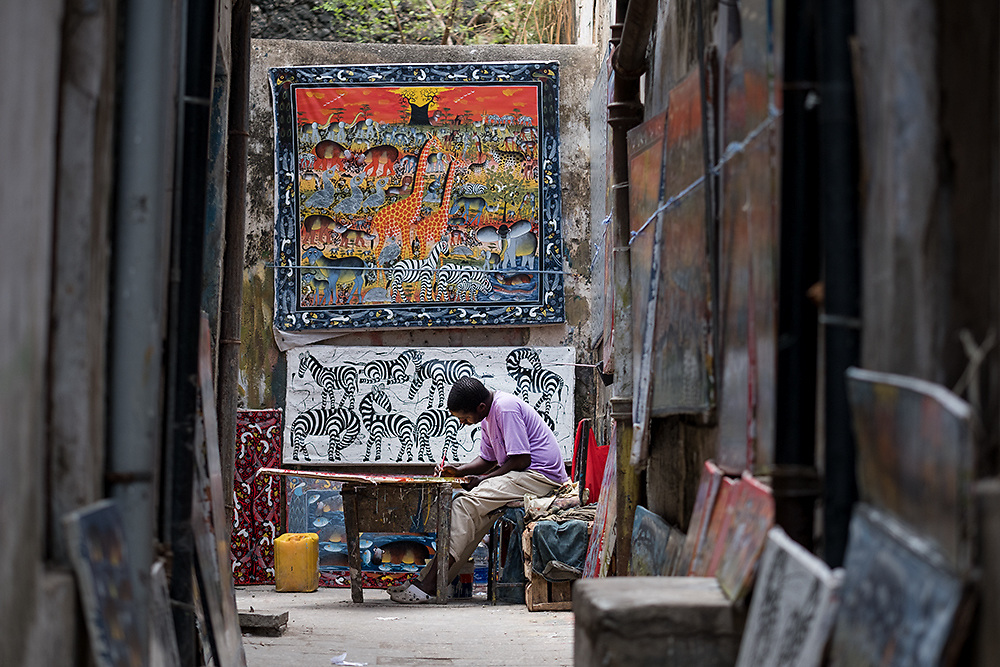 Dar es Salaam, Tanzania - 9/25/16 -  A man painting tourist art in Stone Town, Zanzibar in September  2016. Photo by Daniel Hayduk