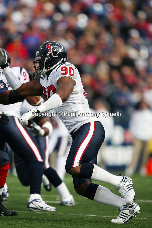 Houston Texans defensive end Mario Williams (90) chases the action during the NFL football game against the Buffalo Bills, November 1, 2009 in Orchard Park, New York. The Texans won the game 31-10. (©Paul Anthony Spinelli)