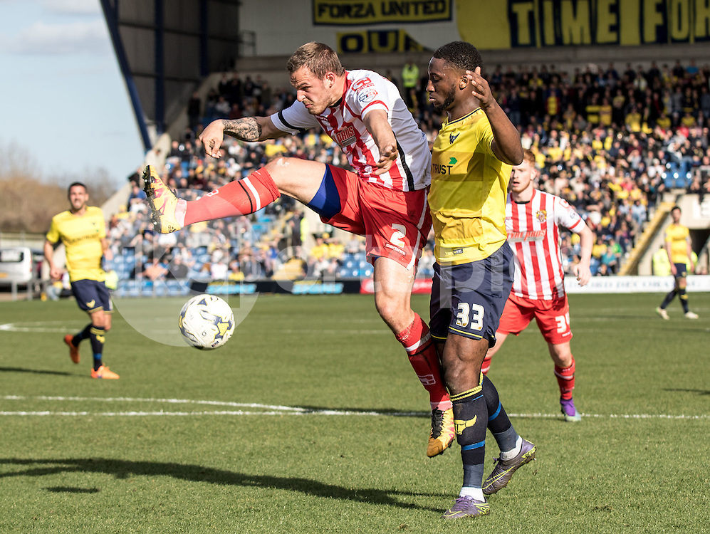 Luke Wilkinson of Stevenage battles with Cheyenne Dunkley of Oxford United during the Sky Bet League 2 match between Oxford United and Stevenage at the Kassam Stadium, Oxford, England on the 25th March 2016. Photo by Liam McAvoy.