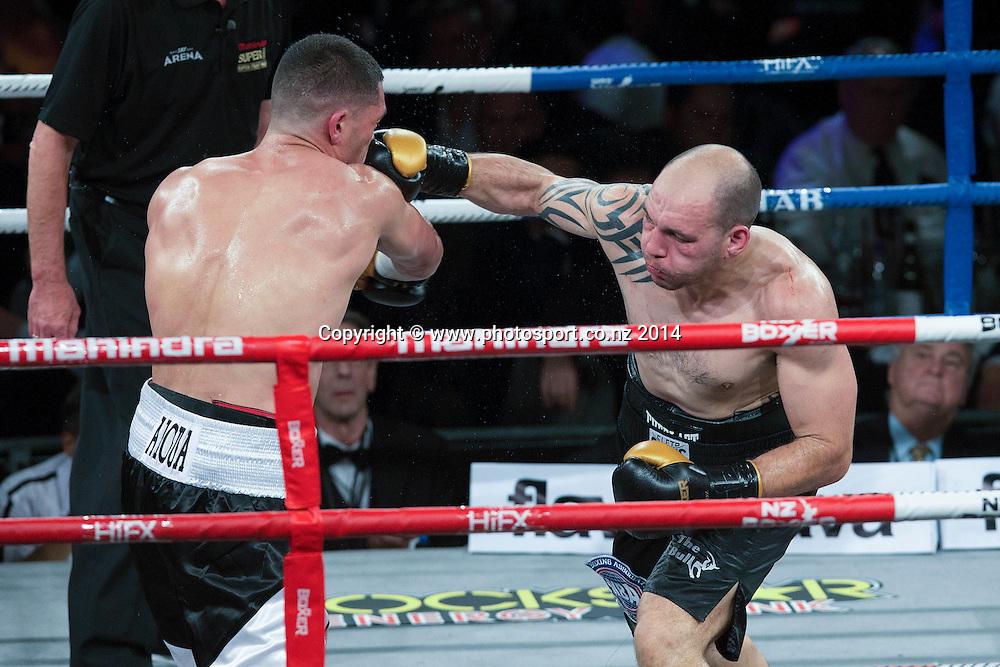 David Aloua (L) fights Anthony McCracken in the Mahindra Super 8 Fight Night, North Shore Events Centre, Auckland, New Zealand, Saturday, November 22, 2014. Photo: David Rowland/Photosport
