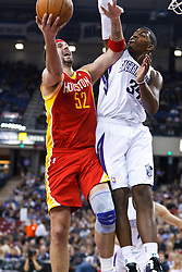 March 7, 2011; Sacramento, CA, USA;  Houston Rockets center Brad Miller (52) is defended by Sacramento Kings center Jason Thompson (34) during the second quarter at the Power Balance Pavilion.