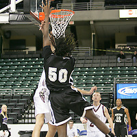Viking forward Darrell Johnson (50) reaches for two.