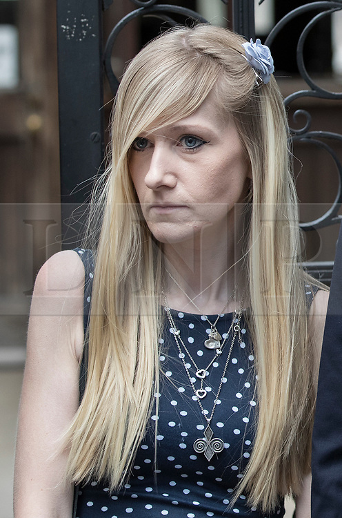 © Licensed to London News Pictures. 10/07/2017. Connie Yates listens as a family friend reads a statement to waiting reporters outside The High Court. The parents of terminally ill Charlie Gard are returning to court in light of claims of new evidence relating to potential treatment for his condition. An earlier lengthy legal battle ruled that Charlie could not be taken to the US for experimental treatment. London, UK. Photo credit: Peter Macdiarmid/LNP
