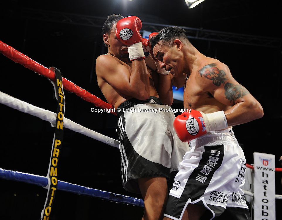 Robin Reid (white shorts) defeats Jamie Ambler at the Reebok Stadium on Saturday 26th February 2011. Hatton Promotions. Photo credit © Leigh Dawney.