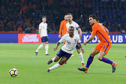 England midfielder Raheem Sterling closes down Netherlands Midfielder Kevin Strootman (Roma), during the Friendly match between Netherlands and England at the Amsterdam Arena, Amsterdam, Netherlands on 23 March 2018. Picture by Phil Duncan.