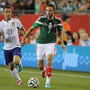 Miguel Layún, (right), Portugal, chased by João Pereira, Portugal, during the Portugal V Mexico International Friendly match in preparation for the 2014 FIFA World Cup in Brazil. Gillette Stadium, Boston (Foxborough), Massachusetts, USA. 6th June 2014. Photo Tim Clayton