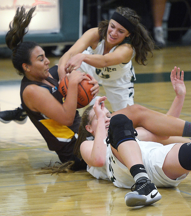 gbs112916k/SPORTS -- Hope Christian's Hanna Valencia, top, Cibola's Tamara Morris, and Hope's Alivia Lewis scramble for the ball during the game at Hope on Tuesday, November 29, 2016. (Greg Sorber/Albuquerque Journal)