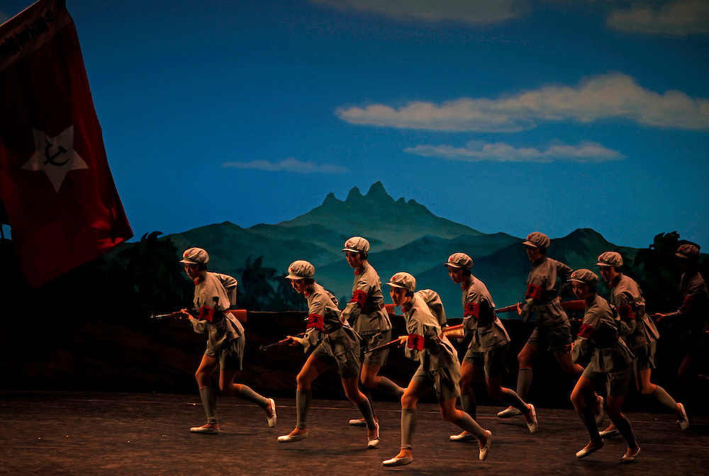 "Dancers from National Ballet of China perform the Mao-era ballet  ""The Red Detachment of Women"" in Beijing, China, Wednesday, Dec. 16, 2009. Signature works such as ""The Red Detachment of Women"",  a rousing story about a peasant girl liberated by communism and her heroic turn in an all-female army troupe, satisfy a taste for nostalgia among China's older audiences and are kitschy fun for younger crowds."