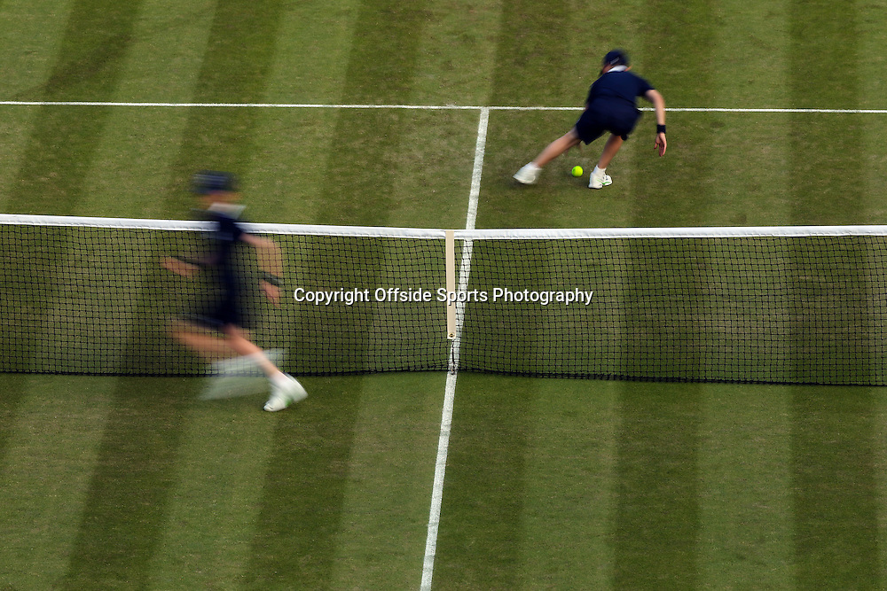 6 July 2015 - Wimbledon Tennis (Day 7) - Ball boys rush to retrieve the ball during the 4th round match between Novak Djokovic (SRB) & Kevin Anderson (RSA) - Photo: Marc Atkins / Offside.