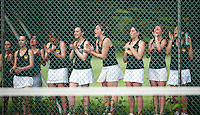 The Bow High School girls tennis team cheers on Nisha Niak in her battle of singles Friday afternoon at Plymouth State University.  (Karen Bobotas/for the Concord Monitor)