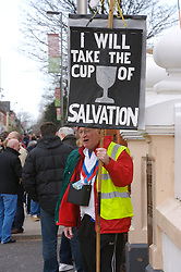 LIVERPOOL, ENGLAND - Saturday, January 26, 2008: A religious man takes his words to Liverpool supporters with a banner 'I will take the cup of salvation' outside Anfield. (Photo by David Rawcliffe/Propaganda)