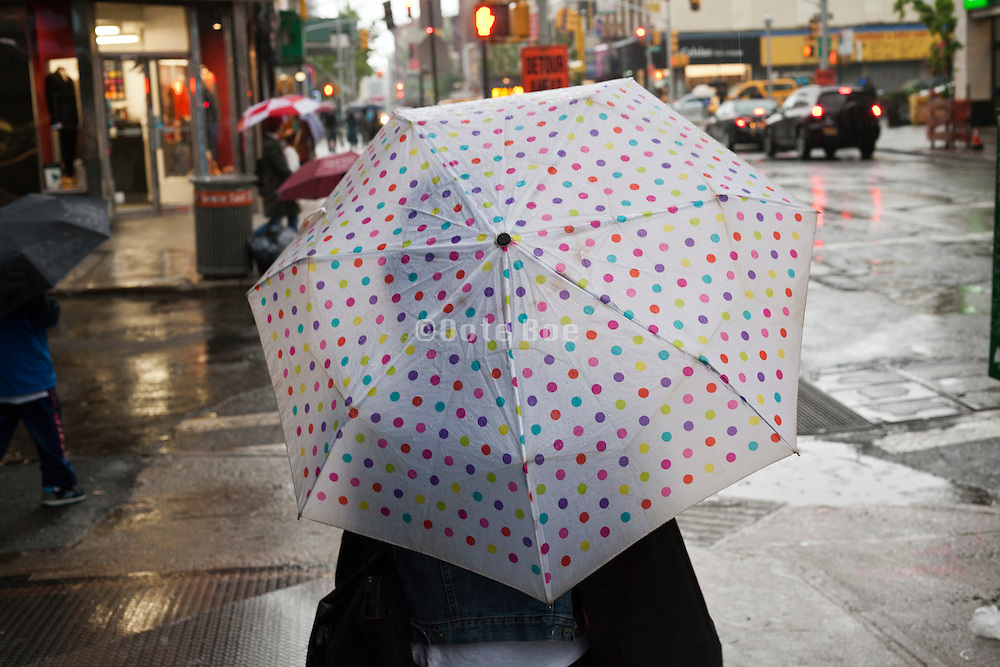 keeping dry under an umbrella