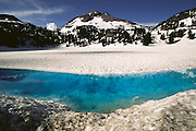 Late spring snowmelt pool in Lassen Volcanic National Park .(Northern California).