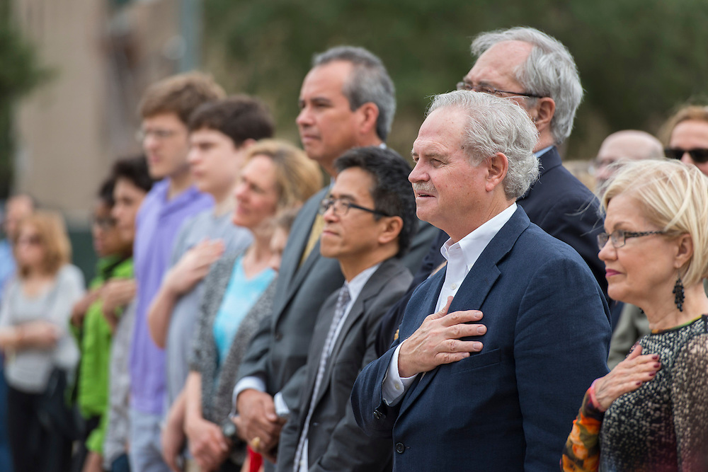 Attendees listen to the national anthem during a groundbreaking ceremony for the new High School for Performing and Visual Arts in downtown Houston, December 14, 2014.