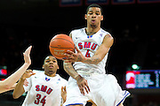 DALLAS, TX - FEBRUARY 6: Keith Frazier #4 of the SMU Mustangs makes a no look pass against the Temple Owls on February 6, 2014 at Moody Coliseum in Dallas, Texas.  (Photo by Cooper Neill) *** Local Caption *** Keith Frazier