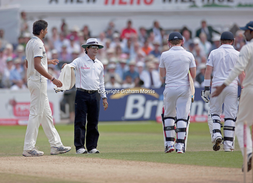 Umpire Asad Rauf (left) watches as Ian Bell (right) walks off (with Eoin Morgan) as Abhinav Mukund removes the bails and appeals to the square leg umpire to run him out during the second npower Test Match between England and India at Trent Bridge, Nottingham.  Photo: Graham Morris (Tel: +44(0)20 8969 4192 Email: sales@cricketpix.com) 31/07/11