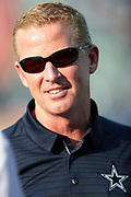 Dallas Cowboys head coach Jason Garrett smiles in the late day sun before the 2017 NFL Pro Football Hall of Fame preseason football game against the Arizona Cardinals on Thursday, Aug. 3, 2017 in Canton, Ohio. The Cowboys won the game 20-18. (©Paul Anthony Spinelli)