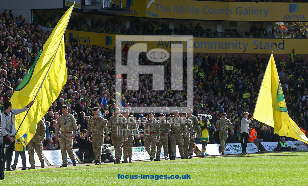 Members of the armed forces parade around the pitch before the Barclays Premier League match at Carrow Road, Norwich<br /> Picture by Paul Chesterton/Focus Images Ltd +44 7904 640267<br /> 22/03/2014