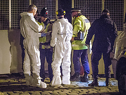 © Licensed to London News Pictures . 30/12/2013 . Manchester , UK . Police and forensic examiners at the scene believed to be where Adam Pickup's body has been discovered , overlooking the Bridgewater Canal near to Deansgate Train Station in Manchester City Centre in Manchester City Centre . The search for 17 year old Adam Pickup who was last seen in the early hours of Saturday 28th December . Photo credit : Joel Goodman/LNP