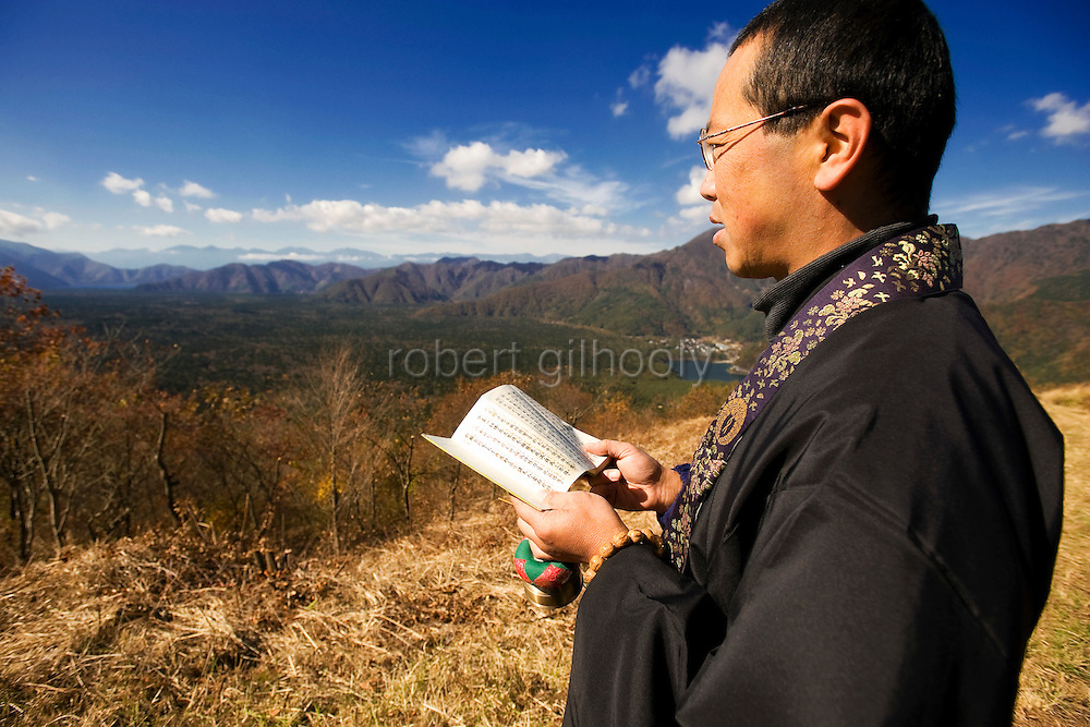 A priest of the Jodo Shinshu sect of Buddhism, offers prayer for those who committed suicide in Aokigahara Jukai, better known as the Mt. Fuji suicide forest, in Yamanashi Prefecture, west of Tokyo, Japan on 04 Nov. 2009. ..