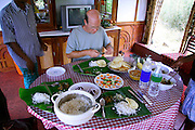man taking lunch on houseboat