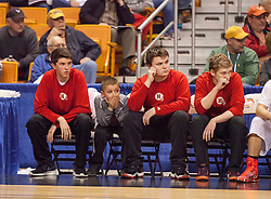 The Hurricane bench watches a free throw during a semi-final game at the Charleston Civic Center.