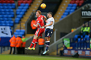 MK Dons defender Dean Lewington out jumps Bolton Wanderers midfielder Liam Feeney  during the Sky Bet Championship match between Bolton Wanderers and Milton Keynes Dons at the Macron Stadium, Bolton, England on 23 January 2016. Photo by Simon Davies.