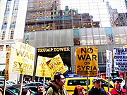 New York. NY. USA-April 7th, 2017-NYC Trump Towers Syria Protest outside Trump Towers on 5th Avenue. People rally in response to Presidents Donald Trumps ordering of airstrikes yesterday on Syrian airbase-Photo By Mark Apollo/Hashtag Occupy Media
