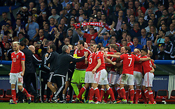 LILLE, FRANCE - Friday, July 1, 2016: Wales players celebrate the second goal, scored by Hal Robson-Kanu, against Belgium during the UEFA Euro 2016 Championship Quarter-Final match at the Stade Pierre Mauroy. (Pic by David Rawcliffe/Propaganda)
