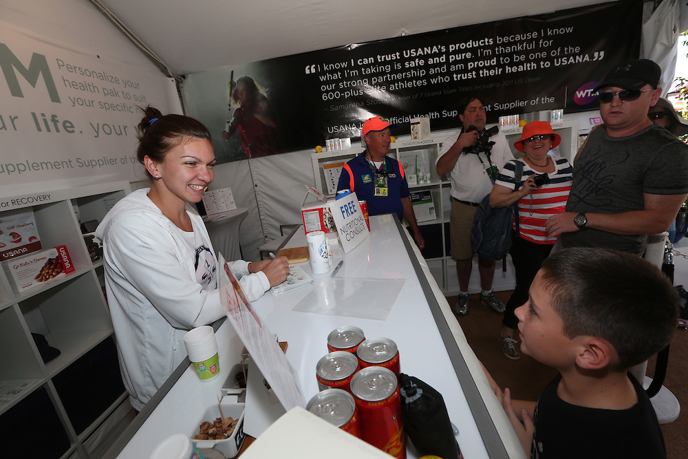 March 8, 2014. Indian Wells, California. Simona Halep signs autographs and greets fans in the USANA Booth at the 2014 BNP Paribas Open. (Photo by Billie Weiss/BNP Paribas Open).