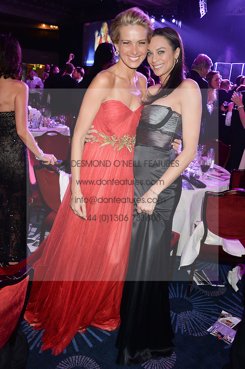 Left to right, PETRA NEMCOVA and LILY BECKER at the Caudwell Children's annual Butterfly Ball held at The Grosvenor House Hotel, Park Lane, London on 15th May 2014.