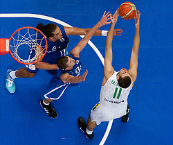 Joakim Noah of France and Nando de Colo of France vs Jonas Valanciunas of Lithuania during basketball game between National basketball teams of Lithuania and France at FIBA Europe Eurobasket Lithuania 2011, on September 9, 2011, in Siemens Arena,  Vilnius, Lithuania. France defeated Lithuania 73-67.  (Photo by Vid Ponikvar / Sportida)