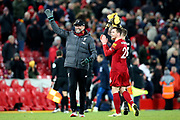 Liverpool Manager Jurgen Klopp and Liverpool defender Andrew Robertson (26) applaud the fans at the end of the Premier League match between Liverpool and Brighton and Hove Albion at Anfield, Liverpool, England on 30 November 2019.