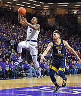 MANHATTAN, KS - JANUARY 09:  Barry Brown Jr. #5 of the Kansas State Wildcats drives in for a basket past Jordan McCabe #5 of the West Virginia Mountaineers during the second half on January 9, 2019 at Bramlage Coliseum in Manhattan, Kansas.  (Photo by Peter G. Aiken/Getty Images) *** Local Caption ***  Barry Brown Jr.; Jordan McCabe