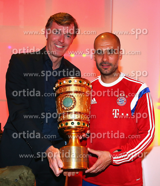 17.05.2014, T Com, Berlin, GER, DFB Pokal, Bayern Muenchen Pokalfeier, im Bild Josep Guardiola (R), head coach of Bayern Muenchen holds the German DFB Cup Trophy with Michael Hagsphil (C), Marketing Director of Telekom Deutschland Josep Guardiola, Michael Hagsphil, // during the FC Bayern Munich &quot;DFB Pokal&quot; Championsparty at the T Com in Berlin, Germany on 2014/05/17. EXPA Pictures &copy; 2014, PhotoCredit: EXPA/ Eibner-Pressefoto/ EIBNER<br /> <br /> *****ATTENTION - OUT of GER*****