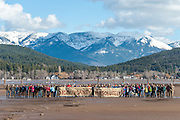"A crowd of 80 people holding banners stating: ""Significant?Absolutely!"" at the Stop the Bridge public rally and demonstration on the north shore of Flathead Lake organized by CANSC (Community Association for North Shore Conservation) on February 15, 2015.  In this photo, only the bridge pilings have been placed as the first phase of construction. The concrete spans are shown in the previous images in this series."