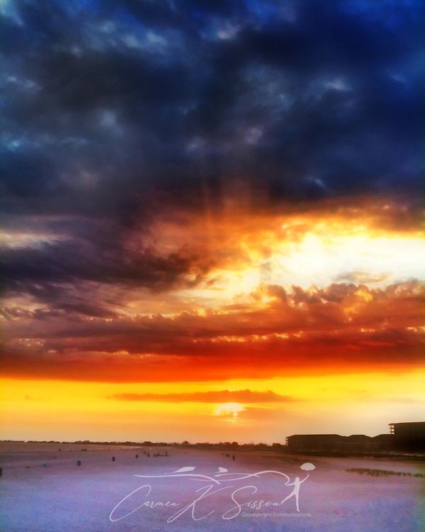 The sun sets on Dauphin Island beach in Dauphin Island, Alabama, July 6, 2012. (Photo by Carmen K. Sisson/Cloudybright)