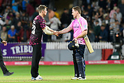 Middlesex win - Eoin Morgan of Middlesex is congratulated by Tom Abell of Somerset during the Vitality T20 Blast South Group match between Somerset County Cricket Club and Middlesex County Cricket Club at the Cooper Associates County Ground, Taunton, United Kingdom on 30 August 2019.