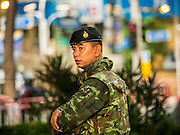 18 AUGUST 2015 - BANGKOK, THAILAND: A Thai soldier on duty at Erawan Shrine Tuesday morning. An explosion at Erawan Shrine, a popular tourist attraction and important religious shrine in the heart of the Bangkok shopping district killed at least 20 people and injured more than 120 others, including foreign tourists, during the Monday evening rush hour. Twelve of the dead were killed at the scene. Thai police said an Improvised Explosive Device (IED) was detonated at 18.55. Police said the bomb was made of more than six pounds of explosives stuffed in a pipe and wrapped with white cloth. Its destructive radius was estimated at 100 meters.    PHOTO BY JACK KURTZ