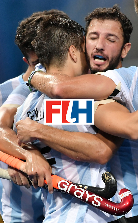 Argentina's Gonzalo Peillat (L) is congratulated by teammates after scoring their third goal during the men's Gold medal field hockey Belgium vs Argentina match of the Rio 2016 Olympics Games at the Olympic Hockey Centre in Rio de Janeiro on August 18, 2016. / AFP / Pascal GUYOT        (Photo credit should read PASCAL GUYOT/AFP/Getty Images)