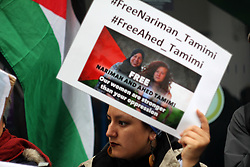 April 28, 2018 - Manchester, Lancashire, United Kingdom - A Palestine Solidarity Protestor waves a protest sign during a Palestinian Solidarity Protest, pleading for the release of two Palestinian sisters held as political prisoners by the IDF (Israeli Defence Force) Nariman and Ahed Tamimi (Credit Image: © Andrew Mccoy/SOPA Images via ZUMA Wire)