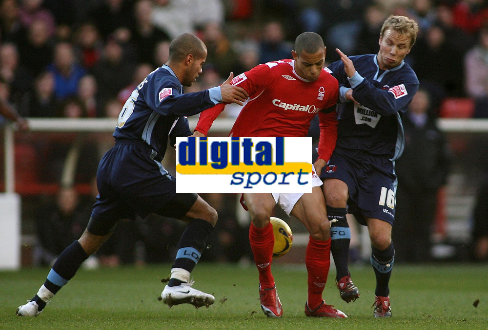 Photo: Paul Thomas.<br /> Nottingham Forest v Leyton Orient. Coca Cola League 1. 16/12/2006.<br /> <br /> Forest's Nathan Tyson (C) battles with Adam Chambers (L) and Luke Guttridge (R) for the ball.