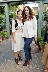 Left to right, EMMA REEVE and CELIA WEINSTOCK at a party to celebrate 'A Year In The Garden' celebrating the first year of The Ivy Chelsea Garden, 197 King's Road, London on 16th May 2016.