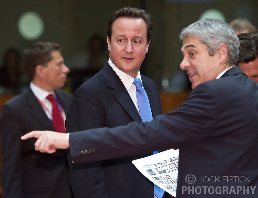 David Cameron, the U.K.'s prime minister, left speaks with Jose Socrates, Portugal's prime minister, during the European Summit meeting at EU Council headquarters in Brussels, Belgium, on Thursday, June 17, 2010. (Photo © Jock Fistick)